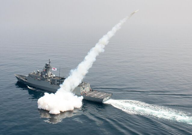 South Korean navy ship fires a missile during a drill in South Korea's East Sea