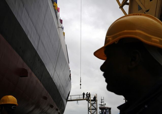 "Workers prepare the indigenously built ""Mormugao"" warship for its launch in Mumbai, India, Saturday, Sept. 17, 2016."
