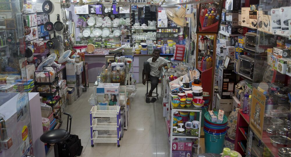 An Indian man waits for customers at a store in New Delhi, India, Saturday, July 1, 2017.