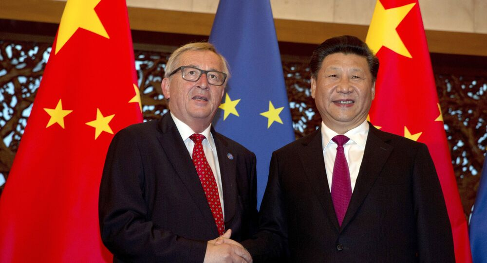 European Commission President Jean-Claude Juncker, left, and Chinese President Xi Jinping pose for a photo before a meeting at the Diaoyutai State Guesthouse in Beijing Tuesday, July 12, 2016.