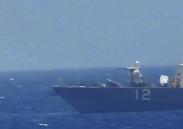 This handout image provided Tuesday, July 25, 2017, from the U.S. Navy purports to show an Iranian vessel making a close approach to a U.S. coastal patrol ship USS Thunderbolt, right. The U.S. Navy patrol boat fired warning shots near the Iranian vessel that American sailors said came dangerously close to them during a tense encounter in the Persian Gulf.