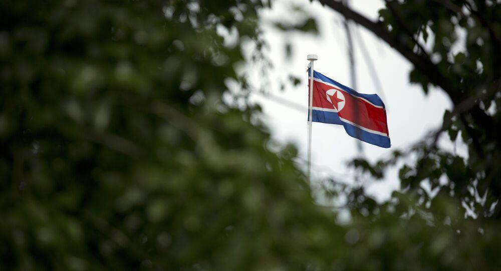 The North Korean flag flies above the North Korean Embassy in Beijing