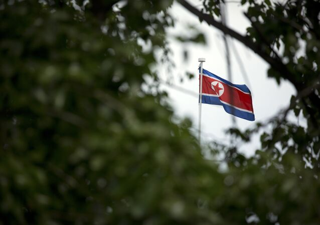 The North Korean flag flies above the North Korean Embassy in Beijing
