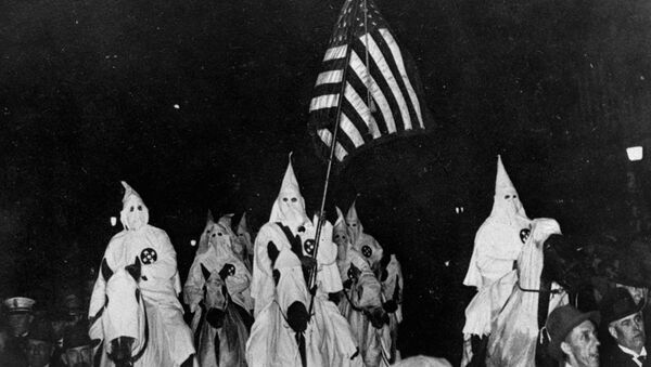 In this September 21, 1923 file photo, members of the Ku Klux Klan ride horses during a parade through the streets of Tulsa, Okla. - Sputnik International
