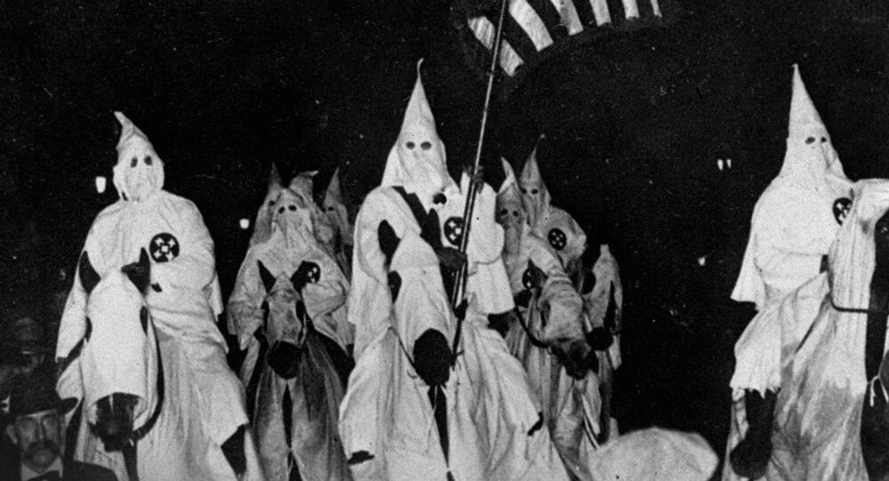 In this September 21, 1923 file photo, members of the Ku Klux Klan ride horses during a parade through the streets of Tulsa, Okla.