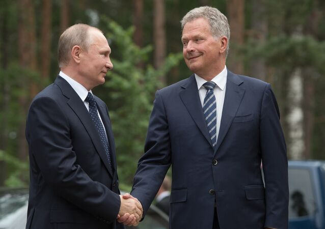 Russian President Vladimir Putin and President of Finland Sauli Niinisto, right, during their meeting