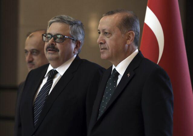 Turkey's President Recep Tayyip Erdogan, right, speaks with the new Russian Ambassador to Turkey, Alexei Yerkhov, as he submits his credentials, in Ankara, Turkey