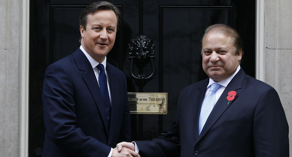 Britain's Prime Minister David Cameron, left, greets Pakistan's Prime Minister Nawaz Sharif at Downing Street in London, Saturday, April 25, 2015.