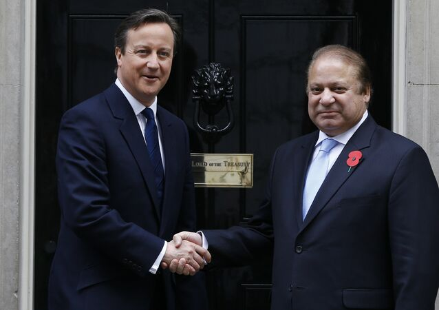 Britain's Prime Minister David Cameron, left, greets Pakistan's Prime Minister Nawaz Sharif at Downing Street in London, Saturday, April 25, 2015.