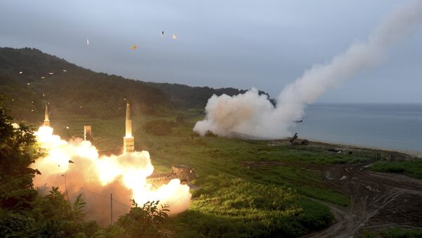 In this photo provided by South Korea Defense Ministry, South Korea's Hyunmoo II Missile system, left, and U.S. Army Tactical Missile System, right, fire missiles during the combined military exercise between the two countries against North Korea at an undisclosed location in South Korea, Saturday, July 29, 2017. - Sputnik International