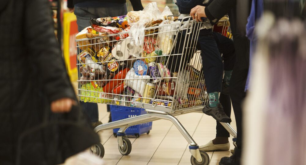 Customers buy in the Tesco supermarket in Nagykanizsa 208 km southwest of Budapest, Hungary. File photo