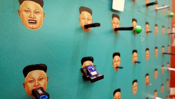 Donated flash drives are shown with images of North Korean leader Kim Jong-un on Human Rights Foundation's Flash Drives for Freedom wall during the Def Con hacker convention in Las Vegas, Nevada, U.S. on July 29, 2017 - Sputnik International