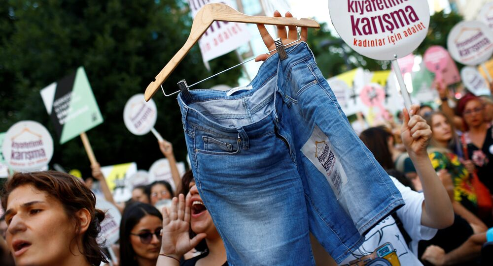 Women rights activists display shorts with a slogan that reads: Don't Mess With My Outfit during a protest against what they say are violence and animosity they face from men demanding they dress more conservatively, in Istanbul, Turkey, July 29, 2017