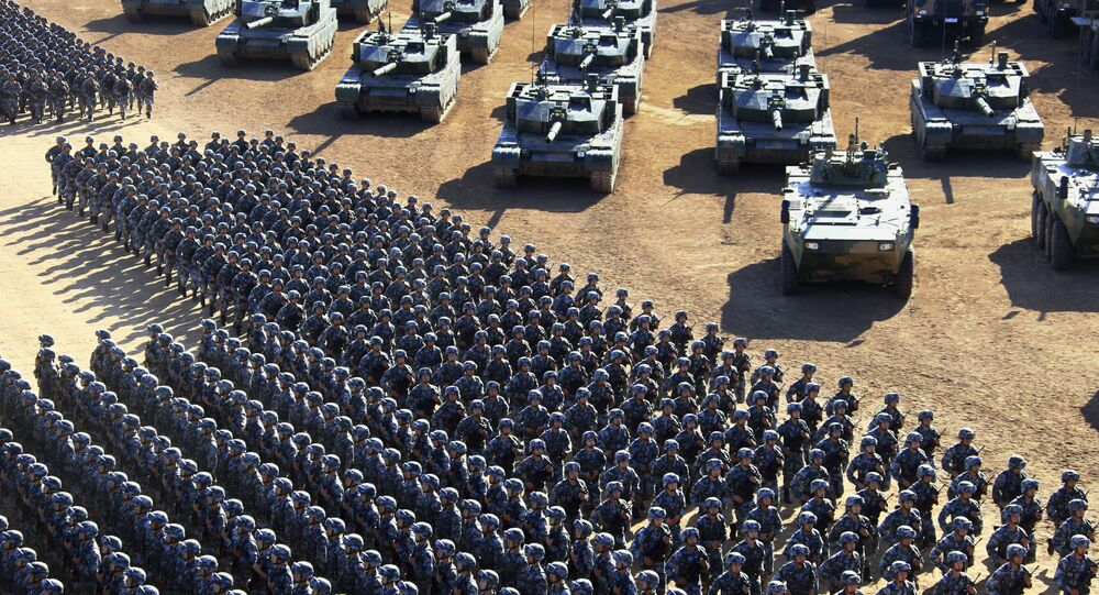 In this photo released by China's Xinhua News Agency, Chinese People's Liberation Army (PLA) troops march past military vehicles Sunday, July 30, 2017 as they arrive for a military parade to commemorate the 90th anniversary of the founding of the PLA on Aug. 1 at Zhurihe training base in north China's Inner Mongolia Autonomous Region