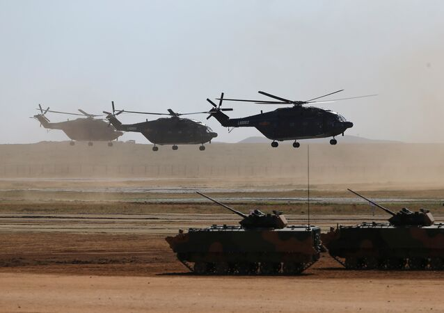 Helicopters and armoured vehicles participate in the military parade to commemorate the 90th anniversary of the foundation of the China's People's Liberation Army (PLA) at Zhurihe military training base in Inner Mongolia Autonomous Region, China, July 30, 2017