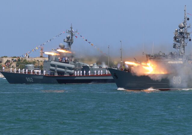 A Russian Navy's minesweeper Kovrovets fires missiles during the Navy Day parade in the Black Sea port of Sevastopol, Crimea, July 30, 2017