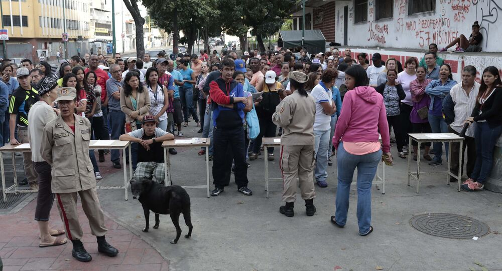 People wait to cast their vote at a polling station during the Constituent Assembly election in Caracas, Venezuela, July 30, 2017