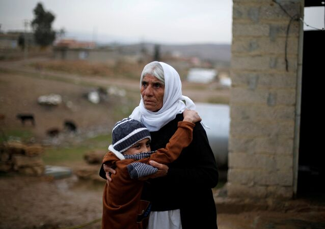 Ayman, a boy from a minority Yazidi community, who was sold by Islamic State militants to a Muslim couple in Mosul, hugs his grandmother after he was returned to his Yazidi family, in Duhok, Iraq, January 31, 2017