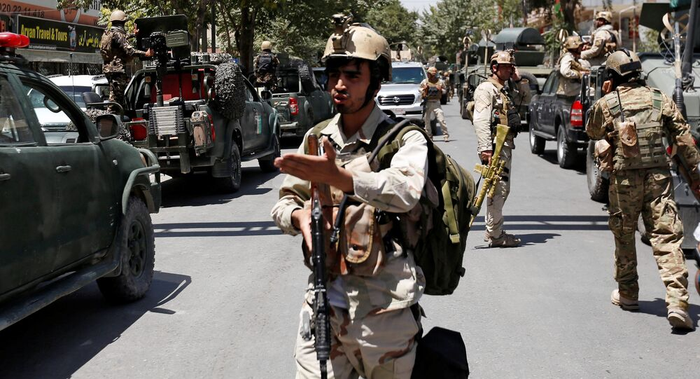 Afghan security forces arrive during gun fire at the site of an attack in Kabul, Afghanistan July 31, 2017