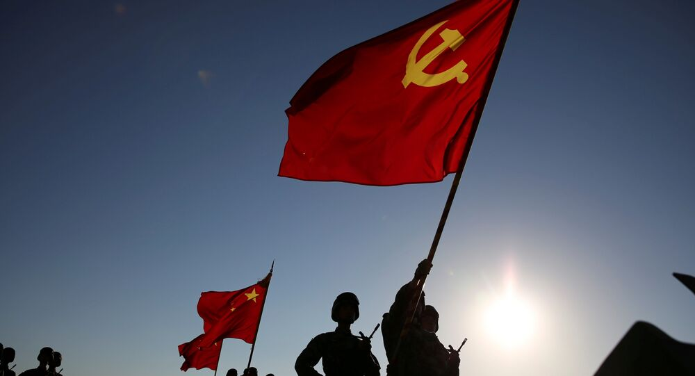 Soldiers carry a PLA flag and Chinese national flags before the military parade to commemorate the 90th anniversary of the foundation of China's People's Liberation Army (PLA) at Zhurihe military base in Inner Mongolia Autonomous Region, China, July 30, 2017