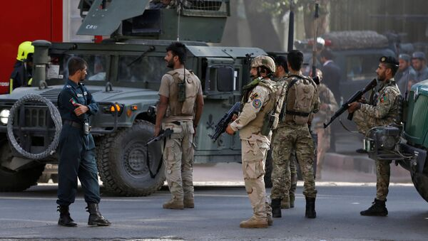 Afghan security forces leave after gunfire at the site of an attack in Kabul, Afghanistan July 31, 2017 - Sputnik International