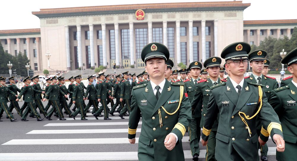Paramilitary policemen march outside the Great Hall of the People after the ceremony marking the 90th anniversary of the founding of the China's People's Liberation Army in Beijing, China August 1, 2017