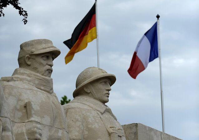 German flag and French flag are pictured in front of the War Memorial 1914-18, on May 27, 2016 in Verdun, eastern France