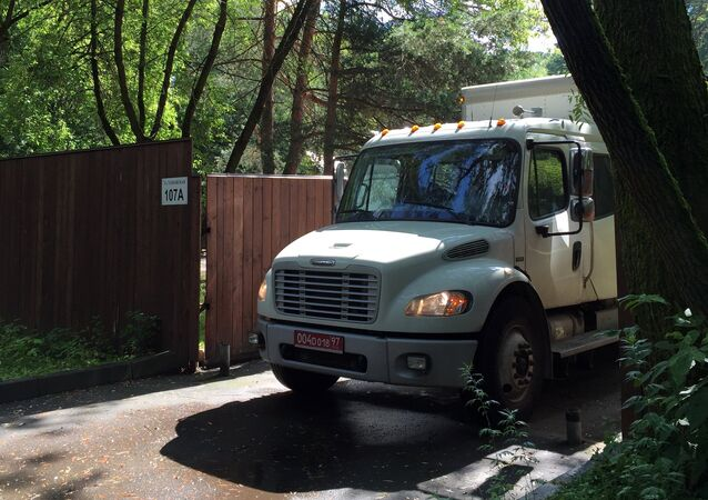 Moscow, Russia. A truck with diplomatic license plates removes property from the US Embassy's weekend houses in Serebryany Bor. In response to anti-Russia sanctions, imposed by the US Senate, the Russian For/eign Ministry has prevented the US Embassy from using weekend houses in Serebryany Bor and all warehouse facilities on Dorozhnaya Street from August 1