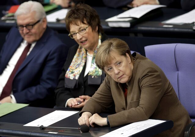 German Chancellor Angela Merkel, right, attends with German Foreign Minister Frank-Walter Steinmeier, left, and State Secretary Brigitte Zypries a meeting of the German Federal Parliament, Bundestag, at the Reichstag building in Berlin, Germany, Thursday, Feb. 25, 2016.