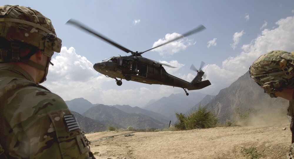 Soldiers with the U.S. Army's 2nd Battalion 27th Infantry Regiment based in Hawaii, pull security as a Blackhawk helicopter lands during an assessment mission to Observation Point Mace days after insurgents attacked four outposts in the area killing some two dozen members of Afghan security forces Saturday, July 9, 2011 in Kunar province, Afghanistan