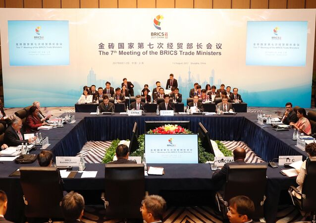 China's Commerce Minister Zhong Shan (center) speaks during the opening ceremony of the 7th Meeting of the BRICS Trade ministers in Shanghai, China August 1, 2017