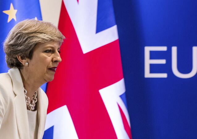 In this Friday, June 23, 2017 file photo British Prime Minister Theresa May prepares to address a media conference at an EU summit in Brussels.