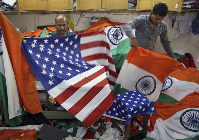 Indian men fold the US and Indian flags at a shop in Mumbai, India (File)
