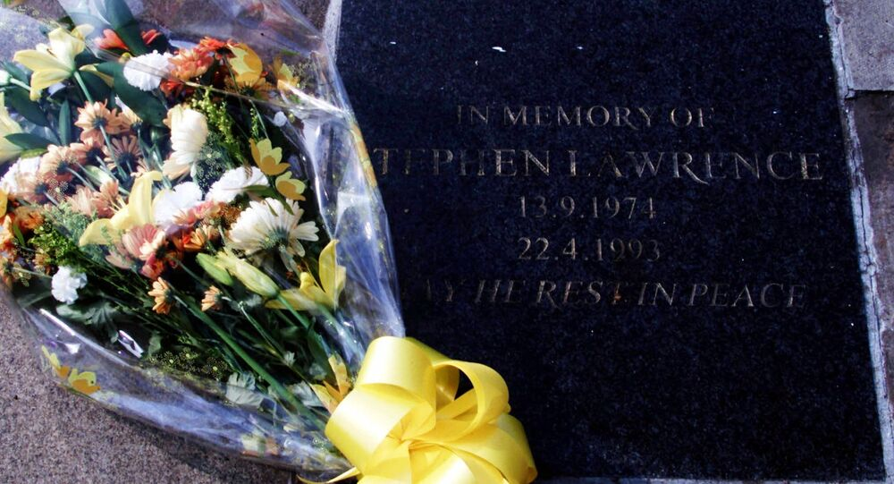 Flowers rest on the memorial plaque to the black teenager Stephen Lawrence, in Eltham located in southeast London Wednesday, March 22, 2000.