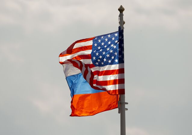 U.S. and Russian national flags wave on the wind (File)