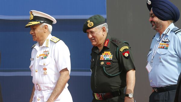 Indian Army Chief Bipin Rawat, center, Air Force Chief Birender Singh Dhanoa, right, and Navy Chief Sunil Lanba arrive at the opening ceremony of Aero India 2017 at Yelahanka air base in Bangalore, India, Tuesday, Feb. 14, 2017 - Sputnik International