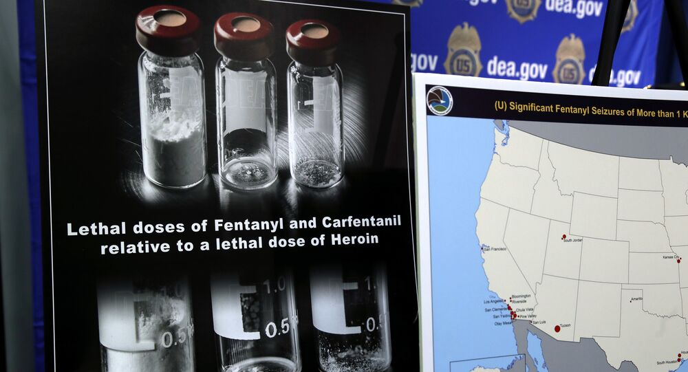 Posters comparing lethal amounts of heroin, fentanyl, and carfentanil, are on display during a news conference about the dangers of fentanyl, at DEA Headquarters in Arlington, Tuesday, June 6, 2017.