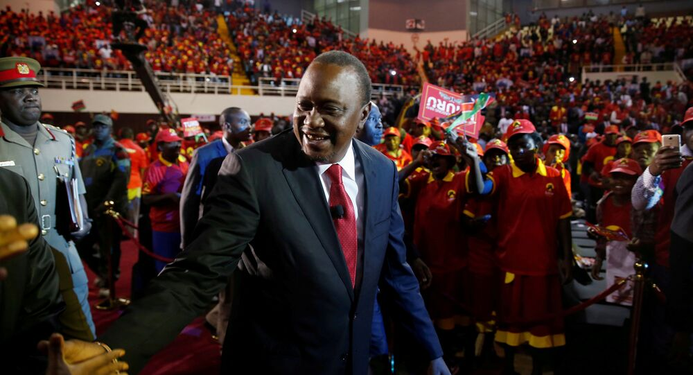 Kenya's President Uhuru Kenyatta arrives to the an event unveiling the Jubilee Party's manifesto in Nairobi.