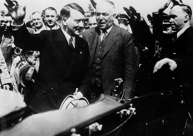 Adolf Hitler, left, Nazi chancellor of Germany, and Konstantin von Neurath, German Minister of Foreign Affairs, (right center) as they returned to Munich, Germany, from their meeting with Premier Benito Mussolini of Italy, June 25, 1934.