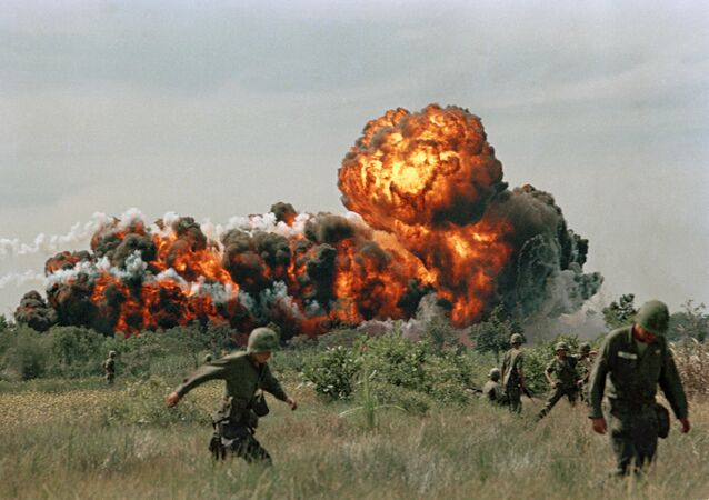 A napalm strike erupts in a fireball near U.S. troops on patrol in South Vietnam, 1966 during the Vietnam War