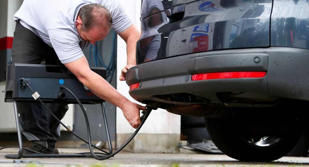 A motor mechanic measures exhaust emissions in a diesel-engined car in Eichenau, Germany July 28, 2017
