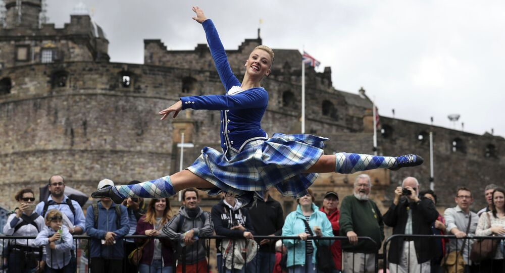 Highland Dancer Elayne Seaton from the Tattoo Dance Company performs on the Edinburgh Castle esplanade after the Royal Edinburgh Military Tattoo programme was revealed by Brigadier David Allfrey, chief executive and producer of the Tattoo, in Edinburgh