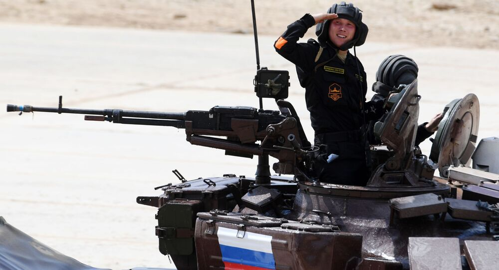 Russian Army team members take part in the tank biathlon individual race during the 2017 International Army Games at the Alabino training center in the Moscow Region