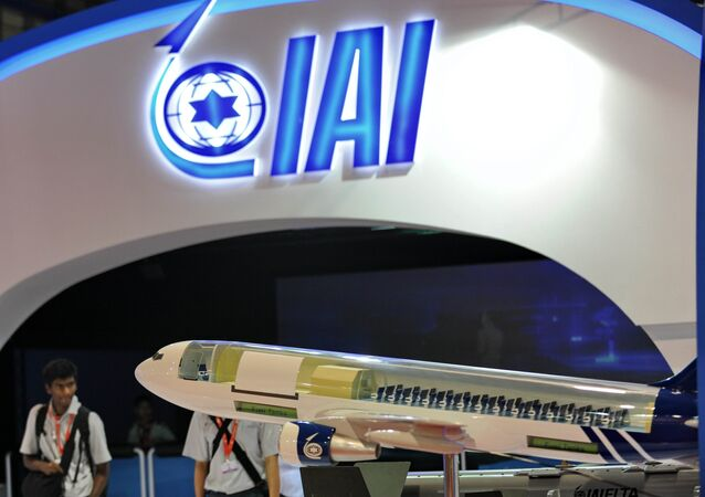 Visitors walk through the Israel Aerospace Industries pavillon at the Singapore Airshow in Singapore. (File)