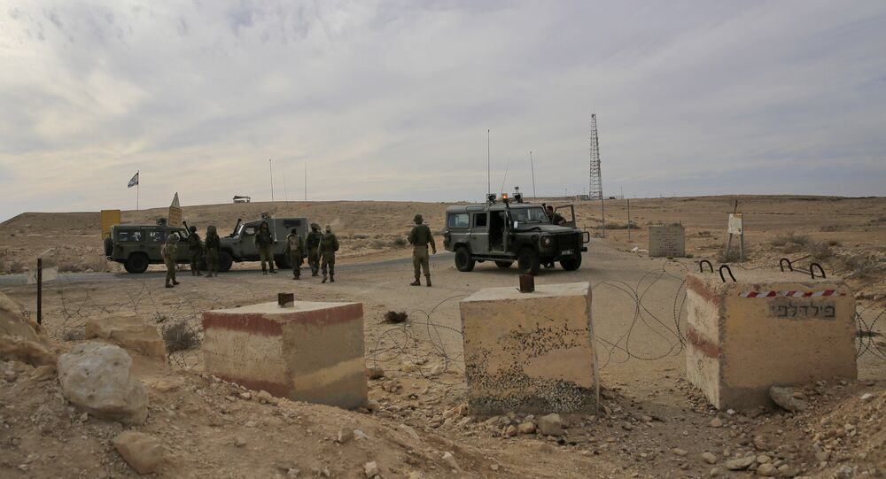 Israeli soldiers stand near the Israel and Egypt border. (File)