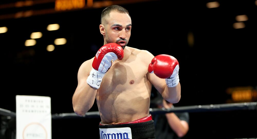 Paul Malignaggi in action against Danny Garcia during their welterweight fight at the Barclays Center in Brooklyn, on Saturday, August 1, 2015.