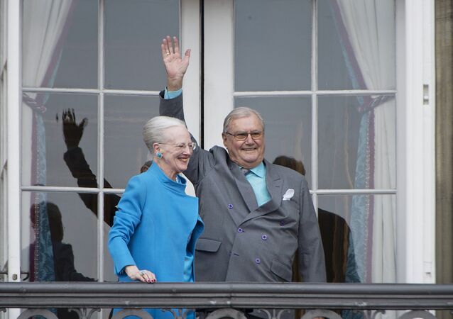 Denmark's Queen Margrethe and Prince Henrik wave from the balcony during Queen Margrethe's 76th birthday celebration at Amalienborg Palace in Copenhagen, Denmark April 16, 2016.
