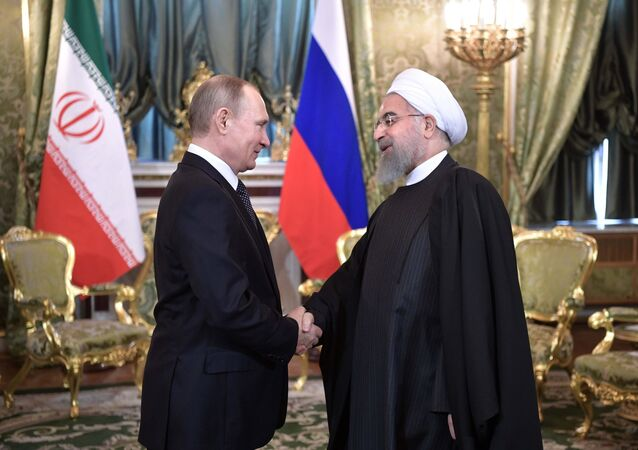 From left: Russian President Vladimir Putin meets with President of the Islamic Republic of Iran Hassan Rouhani