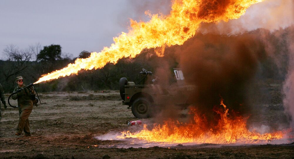 Sunni Michael demonstrates a flamethrower that will be used in a re-enactment of the battle of Iwo Jima, marking the 60th anniversary, on a Hill Country ranch in Doss, Texas. (File)