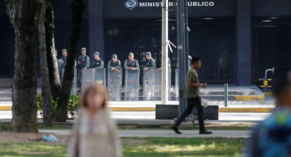 Venezuelan National Guard members stand guard in front of the Prosecutor's office in Caracas, Venezuela